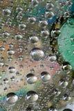 Droppe av vatten på CD och DVD Arkivbilder