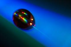 Droppe av vatten som ligger på en CD diskett Royaltyfri Fotografi