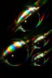 Droppe av vatten som ligger på en CD diskett Royaltyfri Bild