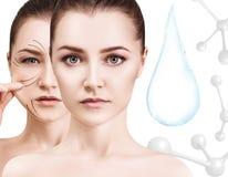 Droppe för vatten för kvinnaframsida near med molekylar framförande 3d Arkivfoton