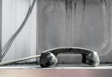Dropped Public telephone handset Royalty Free Stock Images
