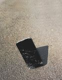 Dropped Smartphone, Cracked on Contact stock photo