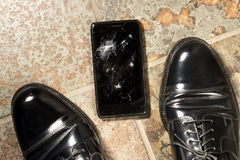 Dropped Smartphone with Cracked Display Royalty Free Stock Photography