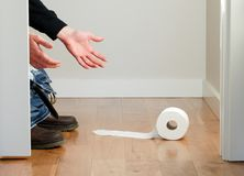 Dropped Toilet Paper Roll Royalty Free Stock Images