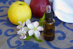 A dropper bottle of apple blossoms extract Royalty Free Stock Photos