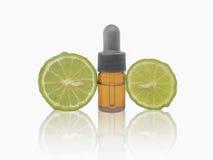 Dropper bottle with kaffir lime. Herbal medicine dropper bottle with kaffir lime stock photo