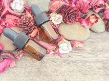 Dropper bottle with red potpourri. Dried flower for spa Background stock photo