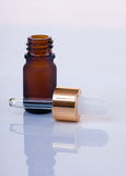 Dropper. Brown dropper in white background royalty free stock photo