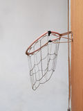 Dropping and broken basketball net. Royalty Free Stock Photo