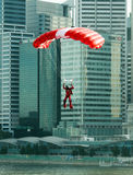 Dropping into the City. Skydiver from the SAF commando team, Red Lions, landing in the city in a preview of the 43rd Singapore national Day Parade held on the 12 Stock Photography