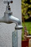 Dropping faucet Stock Photography