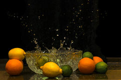 Dropping fruits. Water splash after dropping fruit stock image