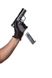 Dropping a Handgun Clip. A man reloading a weapon drops the clip from a black handgun.  Works great for crime or home security concepts Stock Image