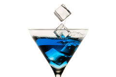 Dropping ice cubes into martini glasses Royalty Free Stock Photography