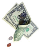 Dropping money. Coins sliding through a rolling bills cilinder Stock Photo