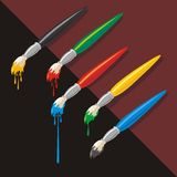 Dropping Paintbrushes Royalty Free Stock Photos