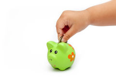 Dropping a piggy bank. stock images
