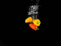 Dropping vegetables. This photo represents freshness in vegetables Royalty Free Stock Images