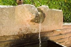 Dropping water in traditional fountain Stock Photos