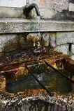 Dropping water from the well in Hallstatt Stock Image