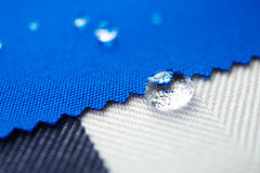 Droppvatten på kanfastyg Royaltyfria Foton