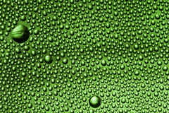 Drops. Water drops on green bottle stock image
