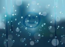 Drops. Smile on a wet rainy window Stock Photo
