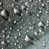 Drops. Water drops on a metal surface Stock Photography