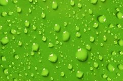 Drops. The green water drops background royalty free stock images