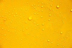 Drops. On a yellow background Stock Images
