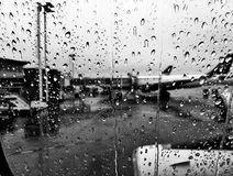 Drops on the airplain window. Water drops on the airplain window while waiting to fly stock images