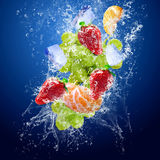 Drops around fruits under water