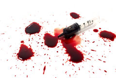 Drops of blood and a syringe Royalty Free Stock Image