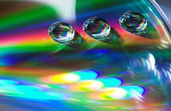 Drops on the CD-disk. Abstraction light on the CD-disk Stock Images