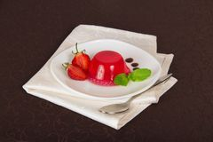 Drops of chocolate and strawberry on a plate from Royalty Free Stock Photography
