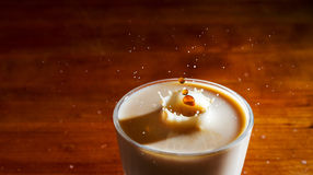 Coffee in milk splash Stock Photography