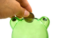 Drops a coin bank. Royalty Free Stock Images