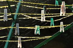 Dew drops in the morning on the clamps and ropes of the green stand. royalty free stock photo