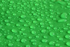 Drops. Drop of water on a green background Royalty Free Stock Photo