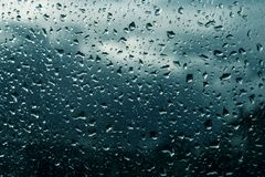 Drops on the glass background. Dark surface stock photography