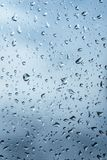 Drops on the glass background. Dark surface royalty free stock photo
