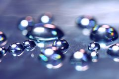 Drops on the glass with reflection. Abstract macro with colorful drops. stock images