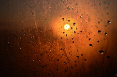 Drops on glass. Sunset after the rain drops on the glass Royalty Free Stock Photo