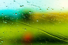 Drops on the glass. Drops on the window of the car in motion Royalty Free Stock Photography