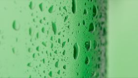 Drops on a green bottle - Macro shot Stock Images