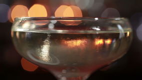 Drops of liquor is dissolving in alcoholic coctail stock video