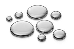 Drops of mercury  on white. Very sharp. Royalty Free Stock Image