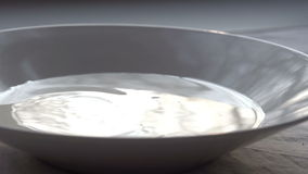Drops of Milk in a Bowl stock footage