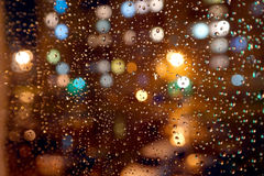Drops of night rain on window Stock Image