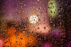Drops of night rain on window, abstract background Royalty Free Stock Images